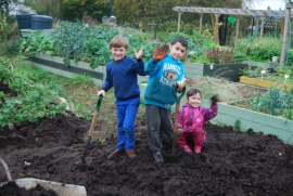Nickolas, Hamza and Zainab busy on the manure pile